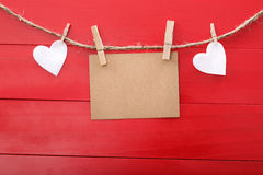 Blank message card and felt hearts with clothespins Stock Photo