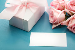 Blank message card with gift box and roses Stock Images