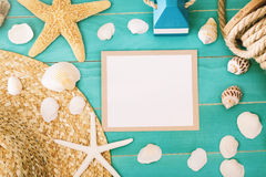 Blank message card with sea shells and straw hat Royalty Free Stock Photography