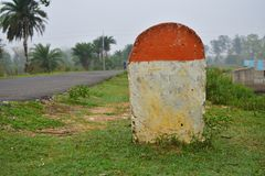 Blank Mile stone in the grass near the road, with print number hundred sign royalty free stock photos