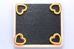 Blank mini blackboard. Blank mini wooden blackboard. deco with rubber hearts .Room for customised text Stock Photos