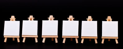 Blank mini signs in a row on black royalty free stock images