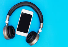 Blank Mobile phone screen inside of headphone Stock Photography