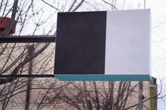 Blank mock-up vintage street signboard in town. Advertising signboard on the street Stock Photo