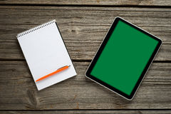 Blank modern digital tablet with papers and pen on Stock Photography