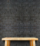 Blank modern wooden table with leg at black brick wall ,Template Royalty Free Stock Photography