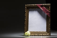 Blank mourning frame for condolence card. On dark background Royalty Free Stock Photo