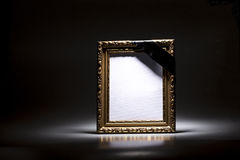 Blank mourning frame on the dark background Stock Photography