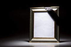 Blank mourning frame on the dark background Royalty Free Stock Images