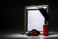 Blank mourning frame on the dark background Stock Photo
