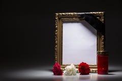 Blank mourning frame on the dark background Stock Image