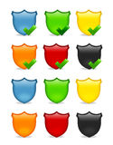 Blank multicolored shield icon set. Empty badge icons in various colors and some with ticks Stock Images