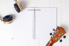 Blank Music Notebook for song writing. With guitar and headphone Royalty Free Stock Photos