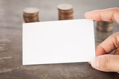 Blank name card with coins Royalty Free Stock Image