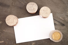 Blank name card with coins Stock Images
