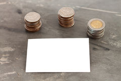 Blank name card with coins Stock Photography