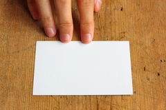 Blank name card. White blank name card on wood background royalty free stock image