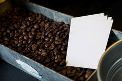 Blank name cards on coffee beans Stock Photo