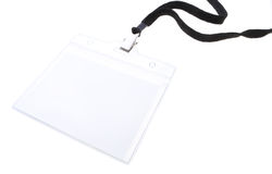 Blank name tag. Blank clip on name tag with copy space in plastic sleeve with black lanyard isolated on white Royalty Free Stock Image