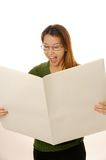Blank newspaper. Beautiful young female is reading blank newspaper Royalty Free Stock Images