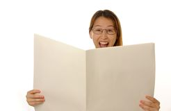 Blank newspaper. Beautiful young female is reading blank newspaper Stock Image