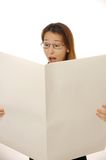 Blank newspaper. Beautiful young female is reading blank newspaper Stock Photography