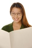 Blank newspaper. Beautiful young female lady is reading blank newspaper Stock Image