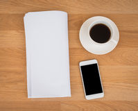 Blank Newspaper with empty space and coffee cup ,mobile phone mo Stock Photos