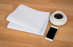 Blank Newspaper with empty space and coffee cup ,mobile phone mo Royalty Free Stock Photo