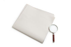 Blank Newspaper and magnifying glass Royalty Free Stock Photos