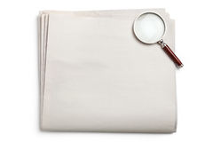 Blank Newspaper and magnifying glass Stock Image