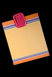 Blank Note. Blank colored note paper hanging from magnetic pinup on black background Stock Images