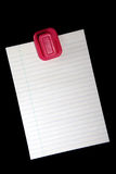 Blank Note. Blank white note paper hanging from magnetic pinup on black background Royalty Free Stock Images