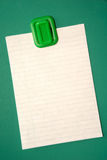 Blank Note. Blank white note paper hanging from magnetic pinup on green background Stock Photography