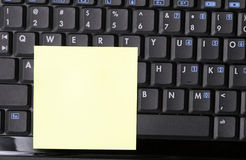 Blank Note On Black Laptop Royalty Free Stock Photo