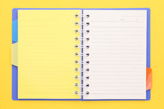 Blank note book. On yellow background Stock Photo