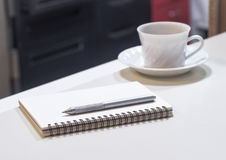 Blank note book with coffee on Table, Office object Stock Photos