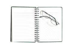 Blank note book and glasses Stock Image