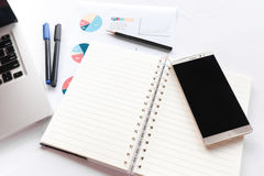 Blank note book with pencil pen laptop and smartphone concept an Royalty Free Stock Image