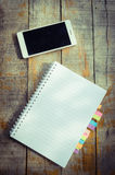 Blank note book with and smart phone Stock Photos