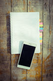 Blank note book with and smart phone Stock Photography