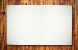 Blank note book on wood texture Stock Photos