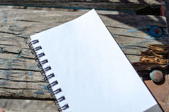 Blank Note Book on Wooden Background Stock Photo