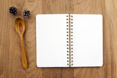 Blank note book and wooden spoon on table Royalty Free Stock Image