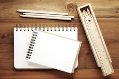 Blank note books ,pencils ,ruler and pencil box on wood backgrou Royalty Free Stock Photography