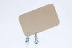 Blank note on brown paper with two metal pins Stock Photography
