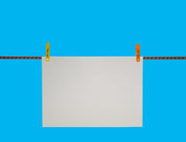 Blank note on a clothesline Royalty Free Stock Photography