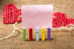 Blank note and color clothespins Royalty Free Stock Images