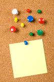 Blank note on cork board. Blank note pinned on cork notice board Royalty Free Stock Images