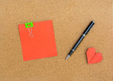 Blank note on cork notice board Stock Photo